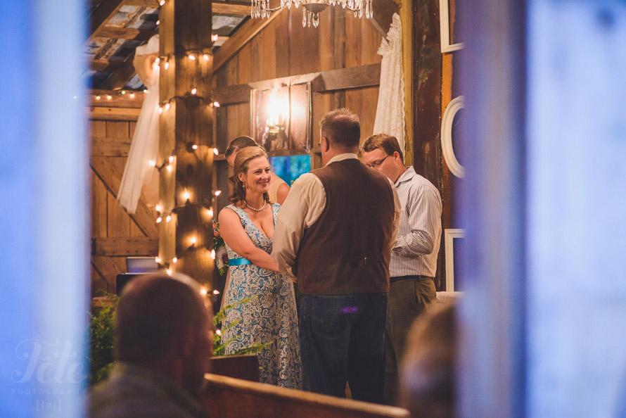 Ceremony inside barn