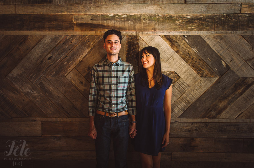 Couple against wooden wall