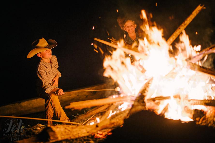 Kid next to bonfire