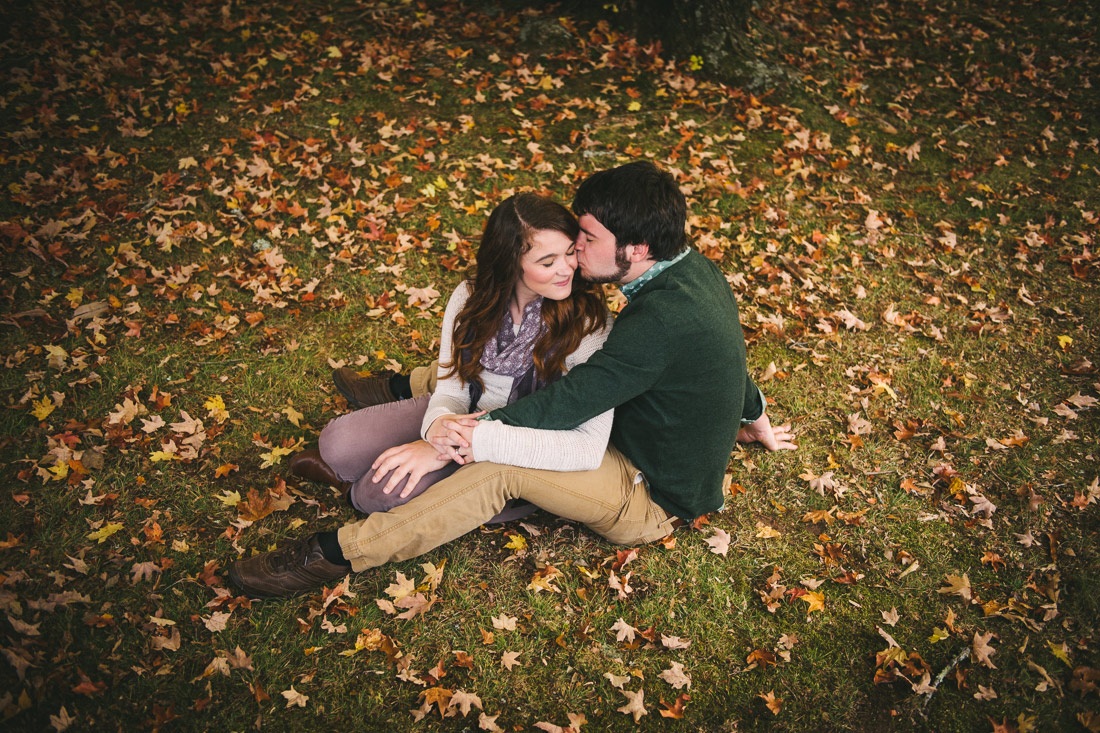 engagement with fall leaves