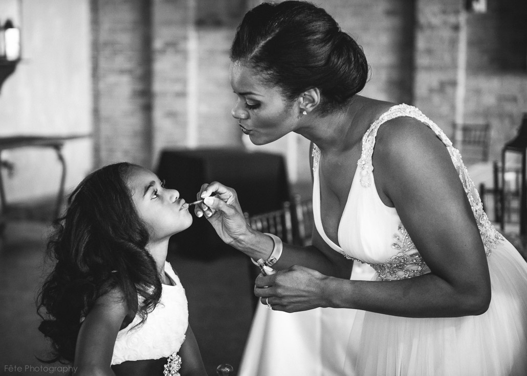 07-bride-putting-makeup-on-flower-girl