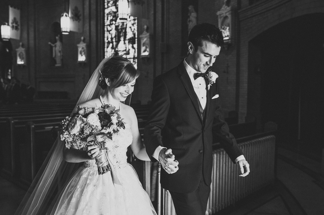 07-bride-groom-exit-basilica-asheville