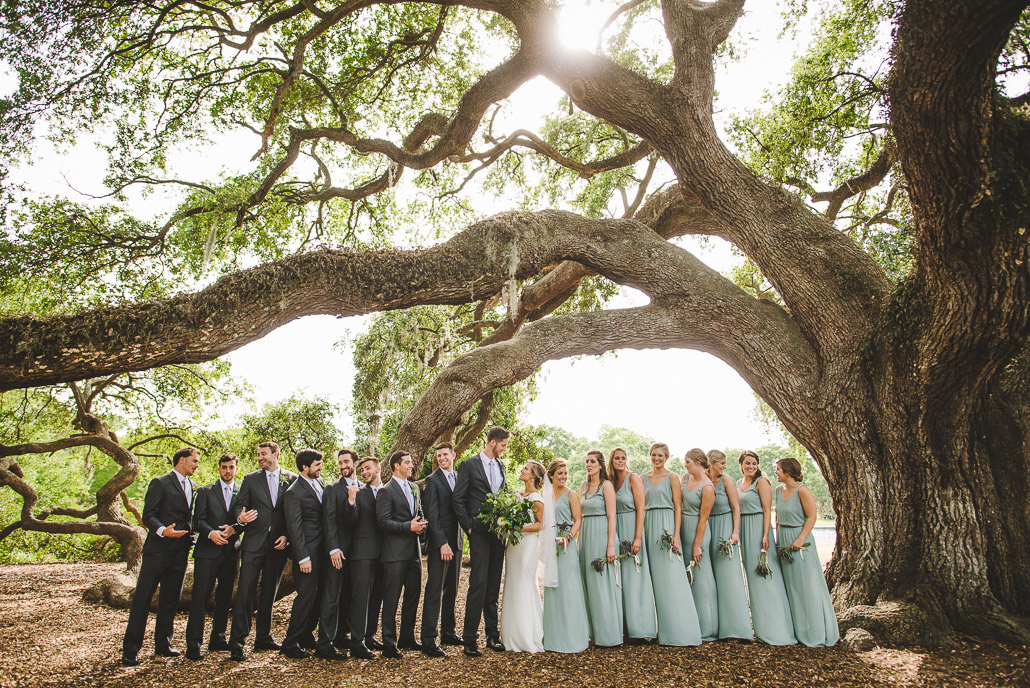 wedding party under oak tree