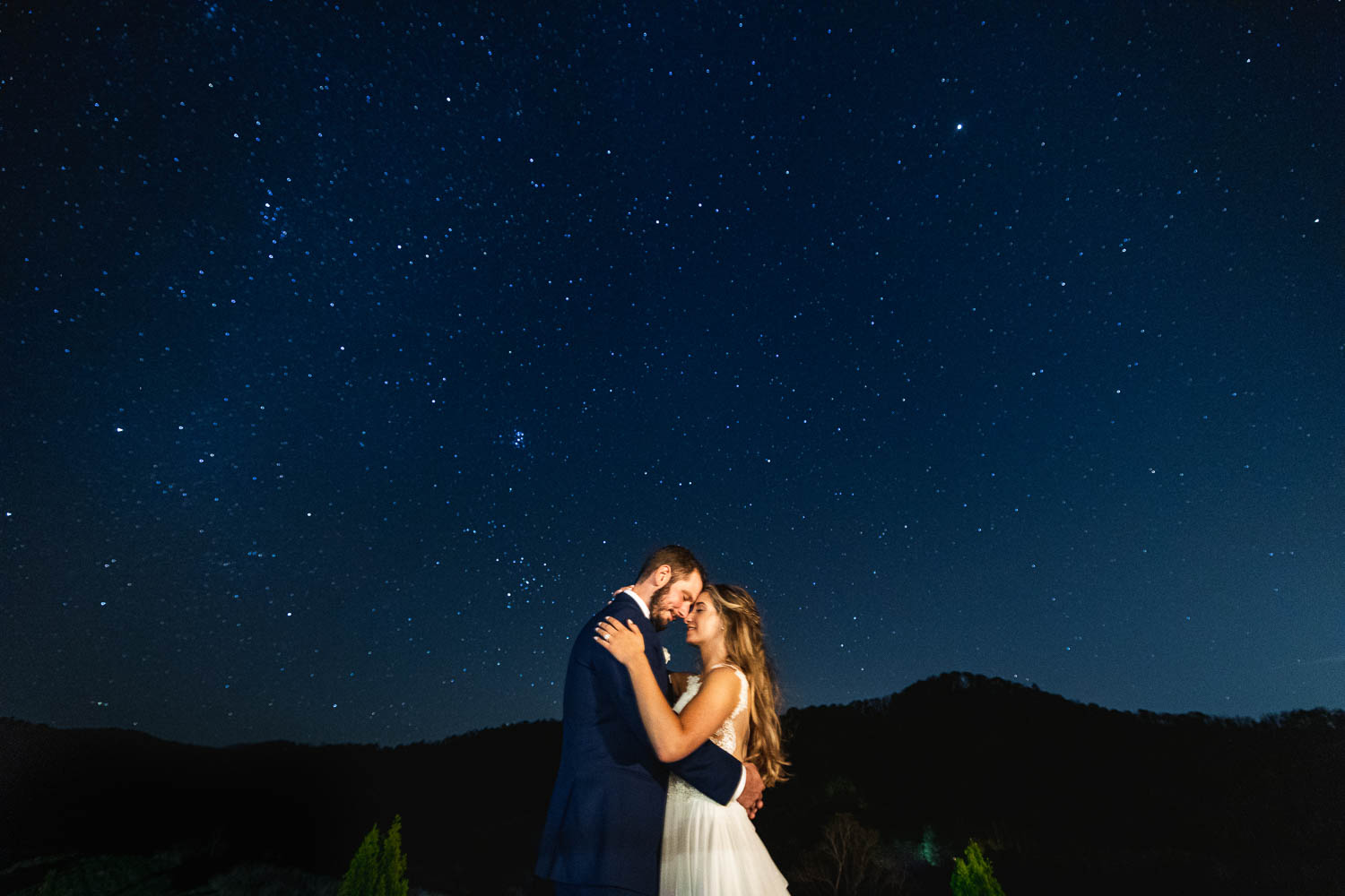 Under the stars, bride and groom photo